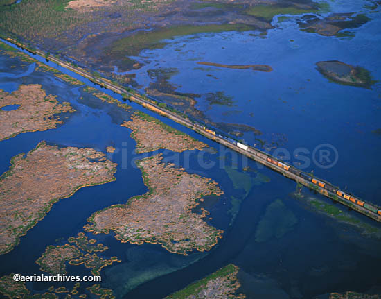 &copy aerialarchives.com freight train crosses wetlands in the Mississippi river delta;  Image ID: AHLB2314