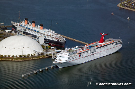 &copy aerialarchives.com aerial  Queen Mary and Carnival cruise ships Paradise vessel Long Beach harbor, California AHLB4686